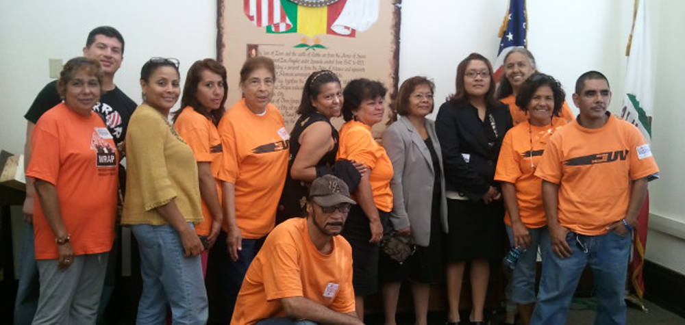 Members of Union de Vecinos and LACAN with Daisy Lopez