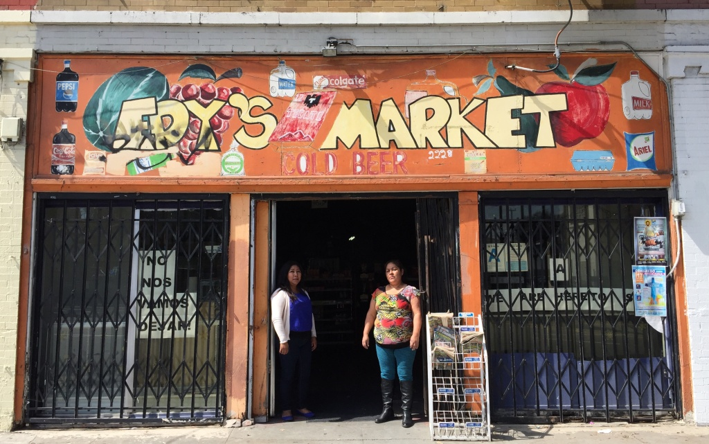 Elvira Barrales and Maria Ramirez stand at the building in Boyle Heights they are being evicted from. Community advocates say the area is seeing rapid change as the Sixth Street Bridge is revitalized.