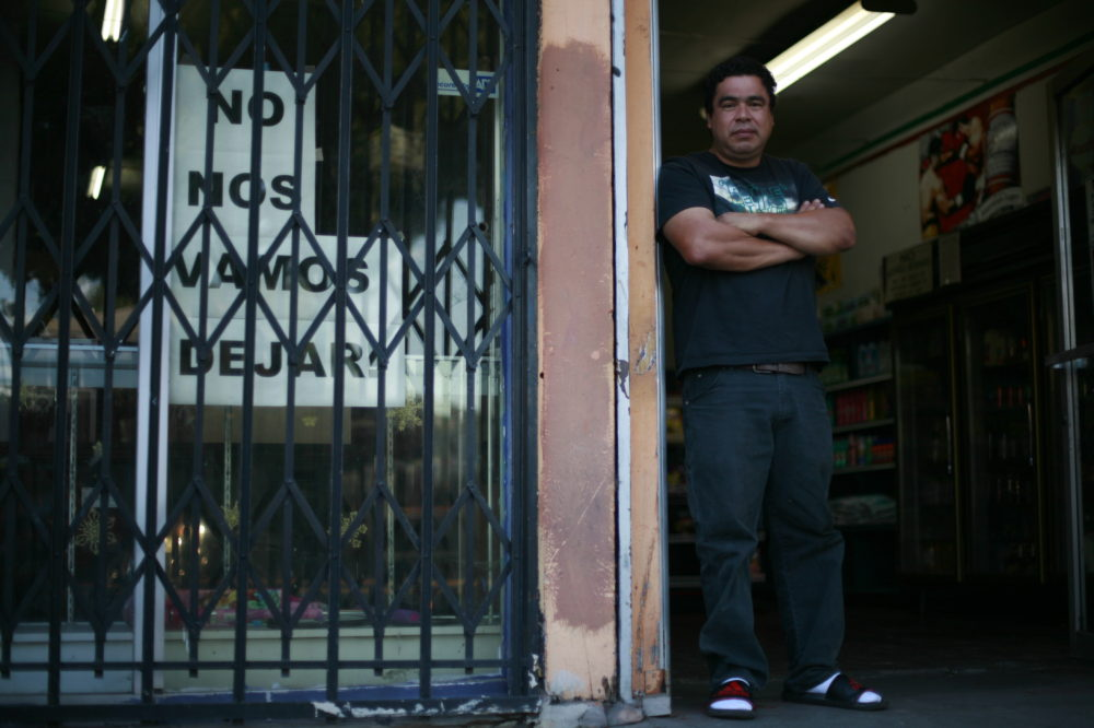 Miguel Ramirez, co-owner of the first-floor OK Market (also known as Edy's Market) in the Hollins building in Boyle Heights, says he and his sister Maria are determined to fight to keep their store. New building owner, Brian Neman, has raised their rent and other tenants in the building. Photo by Luis Rivas