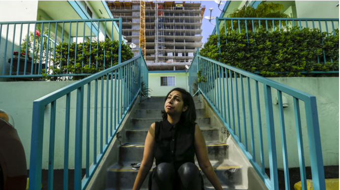 Sasha Ali, a resident of the Yucca-Argyle Apartments, opposes a ballot initiative meant to spur the construction of more affordable housing. (Irfan Khan/Los Angeles Times)