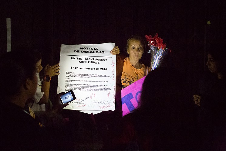 Protesters hold the eviction notice they made for UTA. Image by: Timo Saalermo