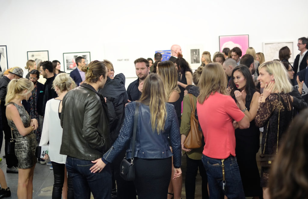 Guests at MAMA Gallery in the Arts District west of Boyle Heights. Courtesy of Michael Buckner/Getty Images for Art of Elysium.